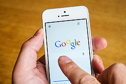Detail of Google search engine homepage on iPhone 5 smart phone