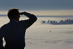 60632286  <br /> Residents watch the foggy scene from a mountain in Vancouver, Canada, Oct. 23, 2013. Thick fog that has blanketed B.C. s south coast for more than a week as a result of ridge of high pressure. Some flights and ferries cancellations, including traffic accidents were happened more frequently during these foggy days, Vancouver, Canada, Wednesday, 23rd October 2013. Picture by  imago / i-Images<br /> UK ONLY