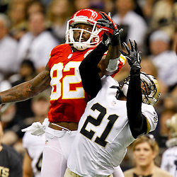 September 23, 2012; New Orleans, LA, USA; New Orleans Saints cornerback Patrick Robinson (21) breaks up a pass to Kansas City Chiefs wide receiver Dwayne Bowe (82) during the fourth quarter of a game at the Mercedes-Benz Superdome. The Chiefs defeated the Saints 27-24 in overtime. Mandatory Credit: Derick E. Hingle-US PRESSWIRE
