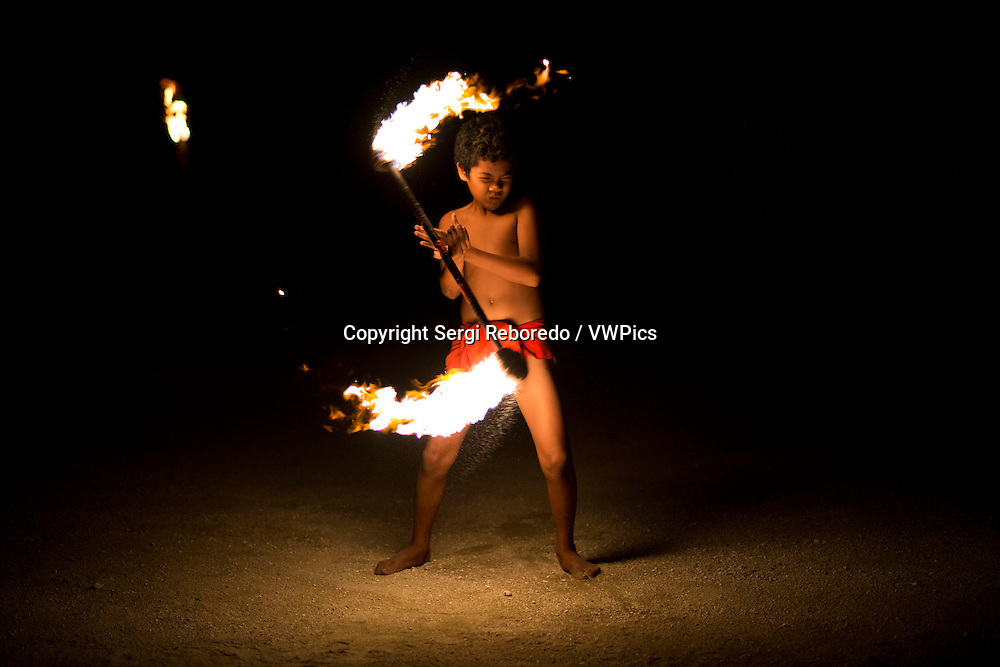 Aitutaki. Cook Island. Polynesia. South Pacific Ocean. A child plays typical fire dances of the Polynesian in the Aitutaki Lagoon Resort & Spa Hotel. Daily Activities Programme. Time and time again our guests remark on how much their holiday has been enriched by the warmth, friendliness, sense of fun and depth of local knowledge shared freely with them by our Activities Team members. And this too is often why they return, time and again, to The Rarotongan rather than stay at an isolated bach. Because here at The Rarotongan, you can enjoy one of the most extensive free activities programmes you are likely to find anywhere on Earth.  It's all laid on, right here at The Rarotongan. Resort Orientation – others include this as a bonus offer (!!), here at The Rarotongan, it's a given … Snorkelling Lessons in the Pool or Lagoon – great for when you're a bit rusty, or haven't had a go before. Very patient, sympathetic instructors.   Snorkelling Safaris in pristine Aroa Lagoon Marine Reserve – it's good to go with a knowledgeable guide, then use our Snorkelling Map another time and do it your way (yip, we even publish an Aroa Lagoon Snorkelling Map – only at The Rarotongan!) Night Snorkelling – unique to The Rarotongan, and one of our most popular and fascinating excursions Fish Feeding – this is one of the absolute highlights for so many guests, young and young at heart! The fish are the friendliest you'll fine anywhere Guided Kayaking Safaris – drink in some great views of the majestic mountains from Aroa Lagoon Guided Nature & Village Walks – The Rarotongan is located in beautiful Aroa, between Rutaki and Kavera villages, well away from any other resorts or hotels.  It's a picturesque little area to explore, especially when you go with someone who knows the locals and the lay of the land. Beach Volleyball on prime Aroa Beach Water Polo in the Waterfalls Pool Tennis Coaching Crab Hunting – of course we employ a catch and release system.