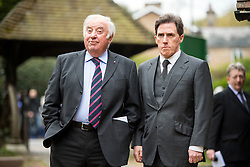 © Licensed to London News Pictures. 18/04/2016. Shirley, UK.  Jimmy Tarbuck (left) and Rob Brydon (right) arrive for the funeral of comedian, actor, writer Ronnie Corbett, held at St John the Evangelist Church in Shirley near Croydon. Corbett, who was most famous for his comedy sketch show  The Two Ronnies, performed with the late Ronnie Barker, died at the age of 85. Photo credit: Ben Cawthra/LNP