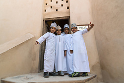Omani schooboys  visiting Nizwa Fort in Oman