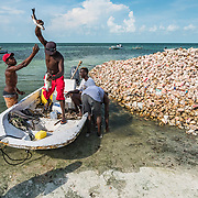 Fisherman in West End, Grand Bahama use fish to settle a small debt.