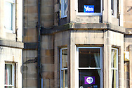 Yes and No posters in Windows above and below in tenement in Brunton Terrace, Edinburgh, Scotland.