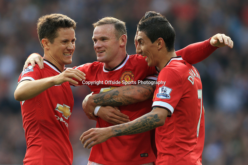 14th September 2014 - Barclays Premier League - Manchester United v Queens Park Rangers - Wayne Rooney of Man Utd celebrates with teammates Ander Herrera of Man Utd (L) and Angel Di Maria of Man Utd after scoring their 3rd goal - Photo: Simon Stacpoole / Offside.