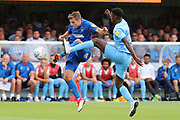 AFC Wimbledon defender Ben Purrington (3) battles for possession with Coventry City Amadou  Bakayoko (21) during the EFL Sky Bet League 1 match between AFC Wimbledon and Coventry City at the Cherry Red Records Stadium, Kingston, England on 11 August 2018.