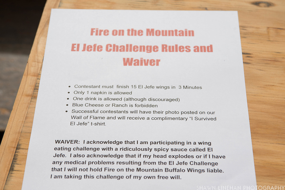 The El Jefe Challenge at Fire on the Mountain - 15 of it's hottest wings in 3 minutes.