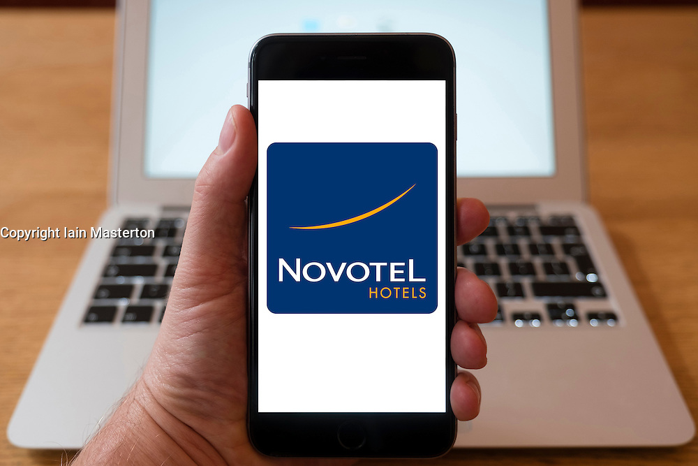 Using iPhone smartphone to display logo of Novotel hotel group