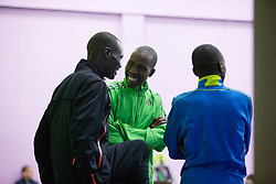 elite runners chat together in holding area prior to race