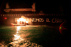 SPAIN GIJON 6OCT08 - Greenpeace activists paint the slogan 'Quit Coal in English and Spanish onto the side of the Windsor Adventure, a coal cargo ship from Colombia into Spain. The action was in protest against against the Spanish government for causing climate change by relying so heavily on coal for the country's energy supply...jre/Photo by GREENPEACE / Jiri Rezac