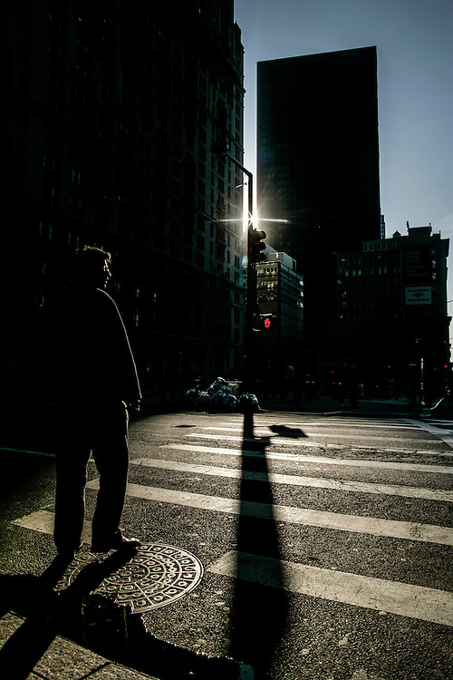Man crosses the streets in New York.