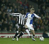 Photo. Aidan Ellis.<br /> Blackburn Rovers v Newcastle United.<br /> FA Barclaycard Premiership.<br /> 11/02/2004.<br /> Blackburn's Johnathon Stead and Newcastle's Olivier Bernard
