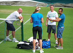 26.06.2012, Wimbledon, London, GBR, WTA, The Championships Wimbledon, im Bild Petra Kvitova (CZE) chats with her coaches David Dydra [r] and David Kotyza [l] after practice during day two of the WTA Tour Wimbledon Lawn Tennis Championships at the All England Lawn Tennis and Croquet Club, London, Great Britain on 2012/06/26. EXPA Pictures © 2012, PhotoCredit: EXPA/ Propagandaphoto/ David Rawcliff..***** ATTENTION - OUT OF ENG, GBR, UK *****