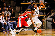 December 28th, 2013:  Georgia Bulldogs sophomore guard Charles Mann (4) drives the ball against Colorado Buffaloes junior guard Spencer Dinwiddie (25) in first half action of the NCAA Basketball game between the Georgia Bulldogs and the University of Colorado Buffaloes at the Coors Events Center in Boulder, Colorado
