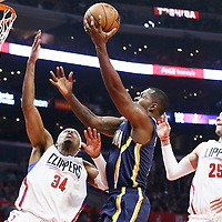 04 December 2016: Indiana Pacers guard Rodney Stuckey (2) goes for the layup past LA Clippers guard Austin Rivers (25) and LA Clippers forward Paul Pierce (34) during the Indiana Pacers 111-102 victory over the LA Clippers, at the Staples Center, Los Angeles, California, USA.