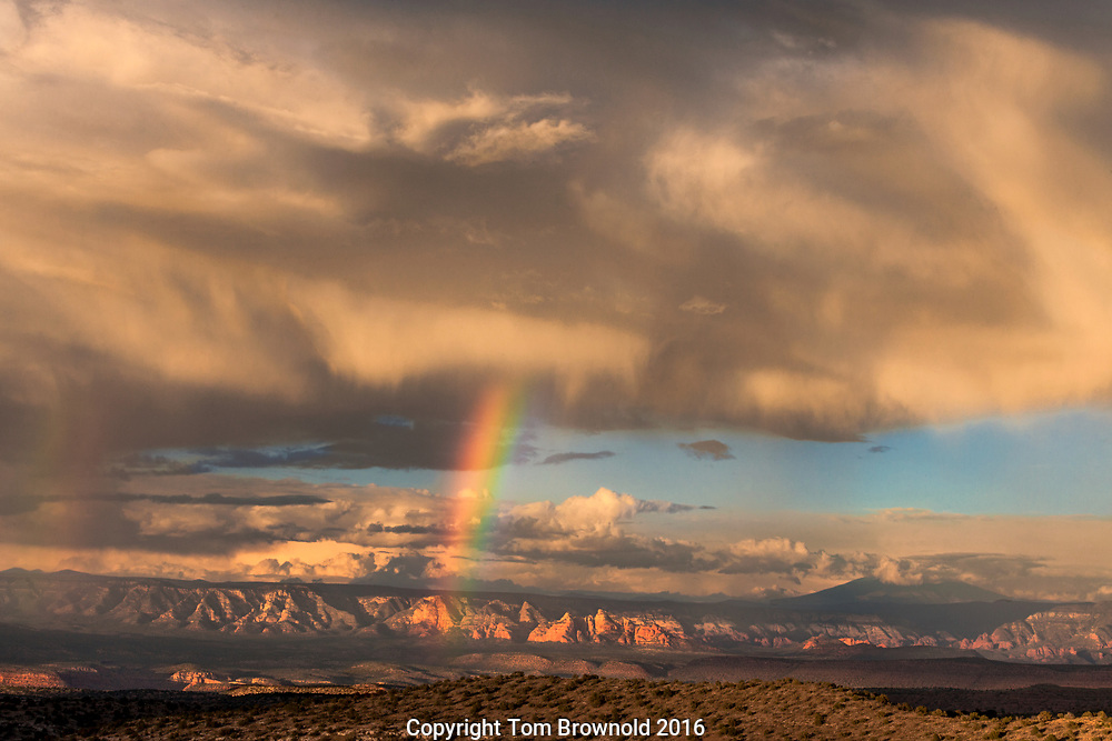 Summer Monsoon showers linger over the upper Verde Valley and the San Francisco Peaks, with the sunset illuminating the Sycamore wilderness area of the Mogollon Rim, Northern Arizona.