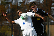Lake Region's Riley Urie (6) and Harwood's Eriks Ziedins (15) battle to head the ball during the DII boys soccer championship game between Harwood and Lake Region at South Burlington High School on Saturday afternoon November 4, 2017 in South Burlington. (BRIAN JENKINS/for the FREE PRESS)