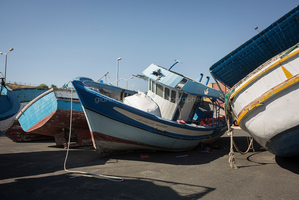 POZZALLO, ITALY - 27 JULY 2015: Wrecks of boats used by smugglers to cross the Mediterrannean Sea with migrants, are here in the so-called boat cemetery of Pozzallo, Sicily, Italy, on July 27th 2015.