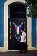 A man walks past a sign advertising the Boy Scouts in Mayaguez Puerto Rico