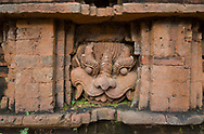 A stone carving of a scary face on a Cham Temple in Group G at the My Son Sanctuary, Quang Nam Province, Vietnam, Southeast Asia