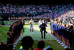LONDON, ENGLAND - Sunday, July 6, 2014: Novak Djokovic (SRB) walks off with the trophy after winning the Gentlemen's Singles Final match 6-7 (7), 6-4, 7-6 (4), 5-7 (4), 6-4 against Roger Federer (SUI) on day thirteen of the Wimbledon Lawn Tennis Championships at the All England Lawn Tennis and Croquet Club. (Pic by David Rawcliffe/Propaganda)