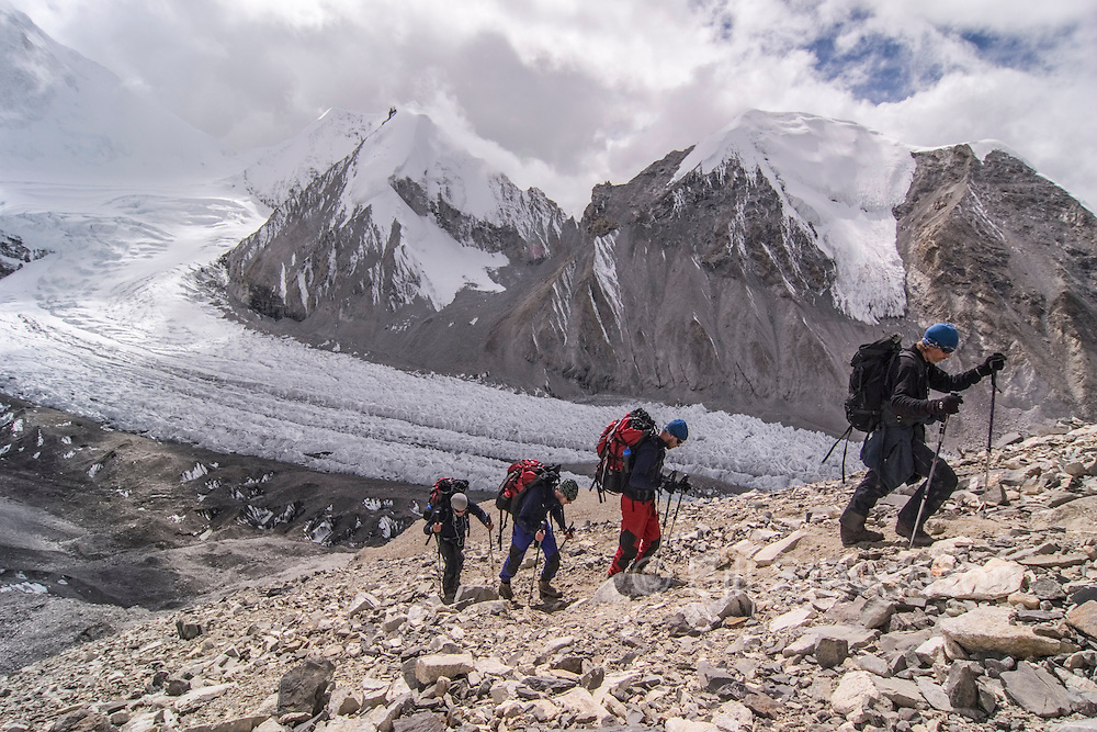 Four climbers going to camp 1 on Cho Oyu in Tibet