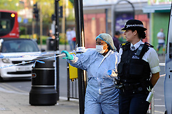 © Licensed to London News Pictures. 06/05/2018. LONDON, UK.  Police and a member of the forensics team at work around cordoned off Palmerston Road in Wealdstone, near Harrow, north west London, following reports of two separate shooting incident around midday on Sunday 6 May 2018.  The two victims are a 12 year old boy and a15 year old boy.  Investigations are ongoing.  Photo credit: Stephen Chung/LNP
