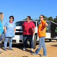 RAY VAN DUSEN/BUY AT PHOTOS.MONROECOUNTYJOURNAL.COM<br /> Save-A-Paw Rescue Volunteer Lisa Shots, left, talks with Shaw Pit Bull Rescue Volunteers Bertha Cisneros, Amy Shaw and Dana McDonald before six pit bulls seized by the Monroe County Sheriff's Office were given over to Shaw for care.