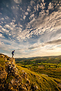 Walker on Knipe Scar in the Lowther valley above Bampton, Lake District, Cumbria, England, UK