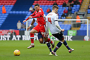MK Dons midfielder, on loan from Brighton & Hove Albion, Jake Forster-Caskey  goes past Bolton Wanderers defender Dorian Dervite  during the Sky Bet Championship match between Bolton Wanderers and Milton Keynes Dons at the Macron Stadium, Bolton, England on 23 January 2016. Photo by Simon Davies.