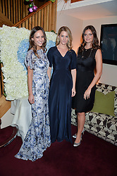 Left to right, LAVINIA BRENNAN, LADY KINVARA BALFOUR and LADY NATASHA RUFUS ISAACS at a party hosted by Lady Kinvara Balfour, Lavinia Brennan and Lady Natasha Rufus Isaacs to celebrate the Beulah French Sole Collaboration in aid of the UN Blue Heart Campaign, held at George, 87-88 Mount Street, London on 10th December 2013.
