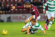 Hearts FC Forward Juanma Dalgado and Celtic FC Defender Jozo Simunovic battle during the Scottish League Cup presented by Ulilita Energy quarter final match between Heart of Midlothian and Celtic at Tynecastle Stadium, Gorgie, Scotland on 28 October 2015. Photo by Craig McAllister.