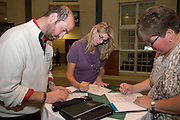 From left: Ryan Geiger, Jennifer Dillie, and Julie Conrad fill out surverys during the Ohio Gurantee Event in Walter Hall Rotunda on Oct. 7, 2014. Photo by Lauren