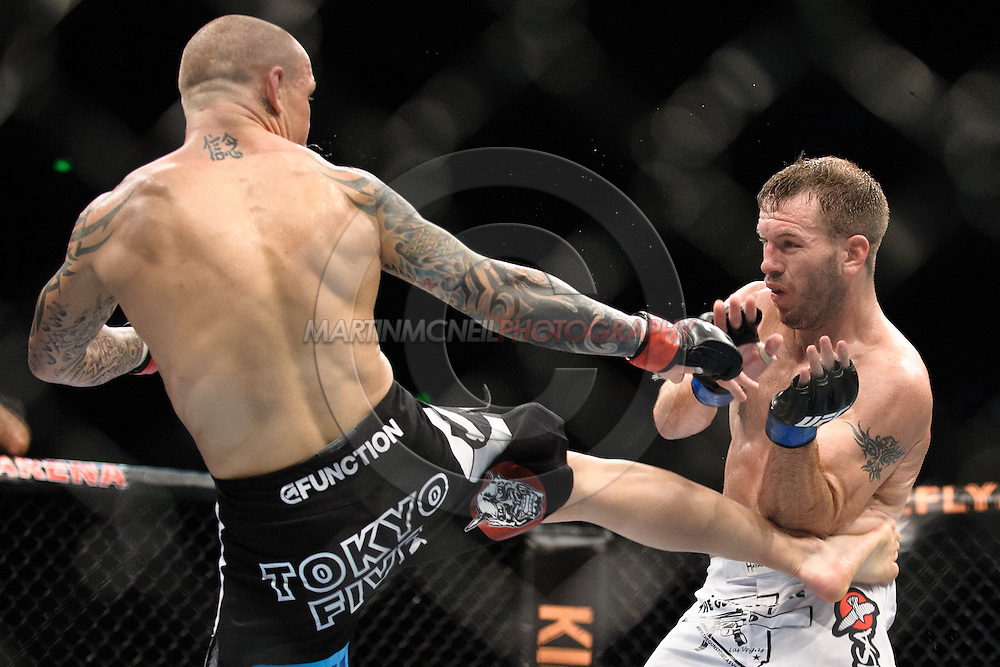 "SYDNEY, AUSTRALIA, FEBRUARY 27, 2011: Ross Pearson (left) lands a kick on Spencer Fisher during ""UFC 127: Penn vs. Fitch"" inside Acer Arena in Sydney, Australia on February 27, 2011."