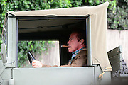17.NOVEMBER.2013. SANTA MONICA<br /> <br /> ARNOLD SCHWARZENEGGER SEEN OUT AND ABOUT IN SANTA MONICA SMOKING A BIG CIGAR WHILST DRIVING IN A VINTAGE ARMY TRUCK.<br /> <br /> BYLINE: EDBIMAGEARCHIVE.CO.UK<br /> <br /> *THIS IMAGE IS STRICTLY FOR UK NEWSPAPERS AND MAGAZINES ONLY*<br /> *FOR WORLD WIDE SALES AND WEB USE PLEASE CONTACT EDBIMAGEARCHIVE - 0208 954 5968*