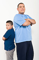Portrait of teenage (16-17) and pre-teen (10-12) boy