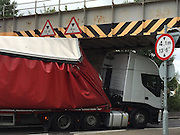 "Lorry collides with railway bridge in Upminster<br /> <br /> A lorry has collided with a railway bridge on St Mary's Lane Upminster in Essex. A c2c spokesman said: ""Network Rail engineers are on site to assess the damage. Trains are currently running through but at a reduced speed.""<br /> ©Exclusivepix Media"
