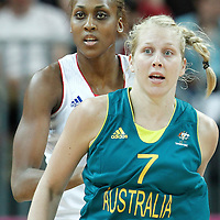 30 July 2012: Sandrine Gruba of France defends on Abby Bishop of Australia during the 74-70 Team France overtime victory over Team Australia, during the women's basketball preliminary, at the Basketball Arena, in London, Great Britain.