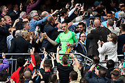 Ederson Moraes (31) of Manchester City walks down the steps from the royal box with the FA Cup as fans take pictures on their phones during the The FA Cup Final match between Manchester City and Watford at Wembley Stadium, London, England on 18 May 2019.