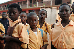 Ghana, Accra, Kokomlemle, 2007. Elementary students appraise the situation while waiting for breakfast at Kwameh Nkrumah Memorial School.