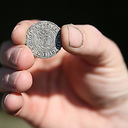 A mudlarker shows a Henry 7th coin that he excavated from the River Thames  in London, Britain May 23, 2016. When the river Thames is at low tide, mudlarkers scour the shore for historical artefacts and remains from there City of London's ancient past. Finds can date back to Roman times to when the city was found up until more recent times. Anyone can walk along the river and look for finds, but the uses of metal detectors and digging is restricted. Mudlarkers need to be licences by the Port of London Authority. All find should be register with the Museum of London. REUTERS/Neil Hall