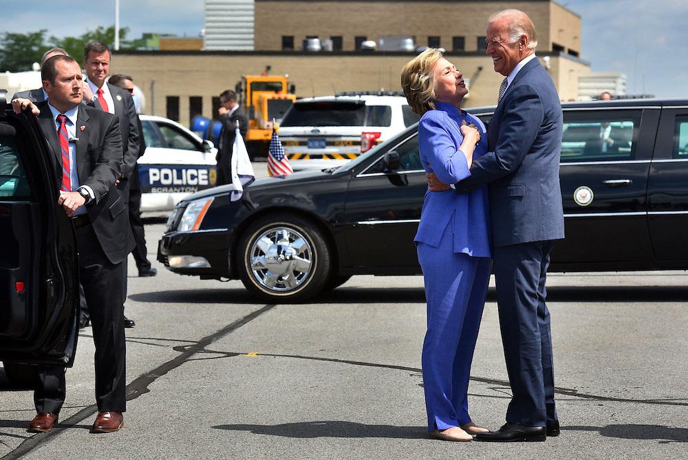 Hillary Clinton hugs Vice President Joe Biden as they meet up in Scranton at the Avoca Airport on Monday. Clinton and Biden both have strong ties to the Scranton area.