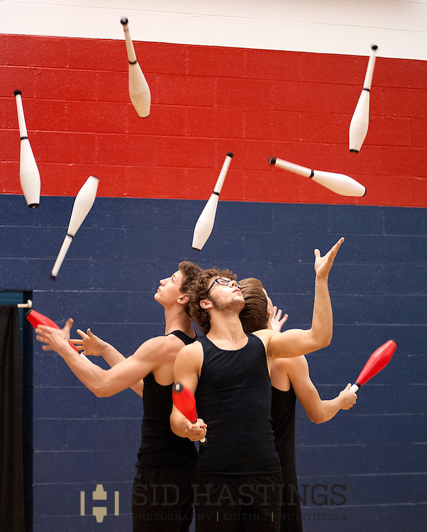 18 JULY 2014 -- CHESTERFIELD, Mo. -- Jugglers Nathan Biggs-Penton (left), Kellin Quinn and Willem McGowan, members of the troupe Company McQuiggs, perform during their show PLD Friday, July 18, 2014 at Barat Academy in Chesterfield. Photo © copyright 2014 Sid Hastings.
