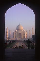 Taj Mahal at Agra; India; at dawn; framed in doorway,