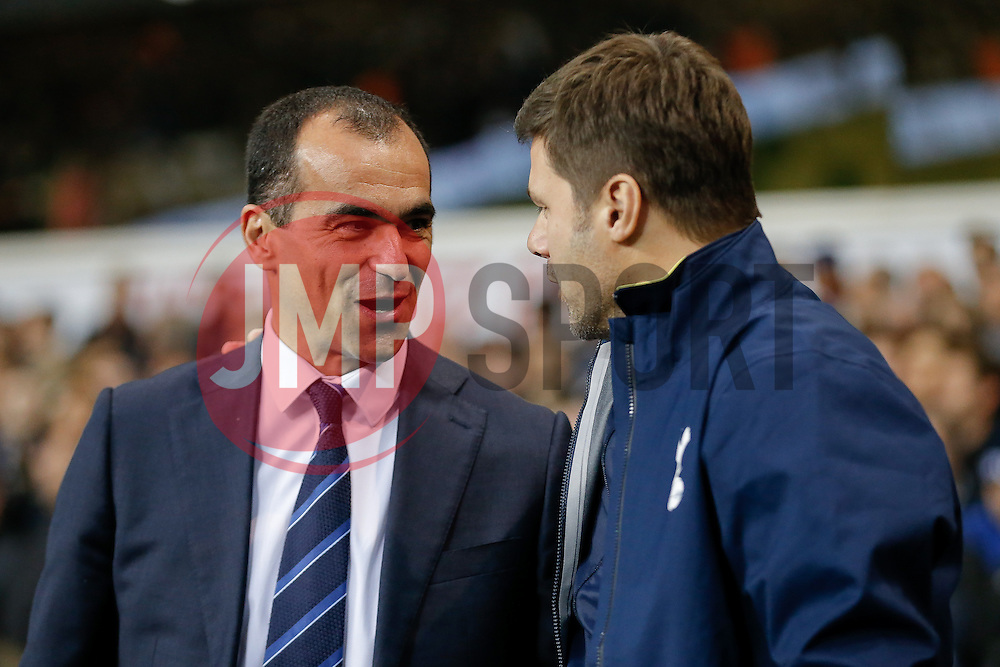 Everton Manager Roberto Martinez is greeted by Tottenham Hotspur Manager Mauricio Pochettino - Photo mandatory by-line: Rogan Thomson/JMP - 07966 386802 - 30/11/2014 - SPORT - FOOTBALL - London, England - White Hart Lane - Tottenham Hotspur v Everton - Barclays Premier League.