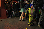 Oct. 25, 2013 - Bronx, NY. A Ninja Turtle waits patiently for the start of the 28th Annual South Bronx Halloween Parade in Hunts Point. 10/25/2013 Photo by Nicholas Wells / CUNY Photo Wire