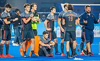 BHUBANESWAR, INDIA -  Teleurstelling bij Oranje  na de verloren shoot outs na  de  finale tussen België en Nederland (0-0)  bij het WK Hockey heren in het Kalinga Stadion. Belgie wint de shoot outs . midden Robbert Kemperman (Ned) , rechts bondscoach Max Caldas (Ned) COPYRIGHT KOEN SUYK
