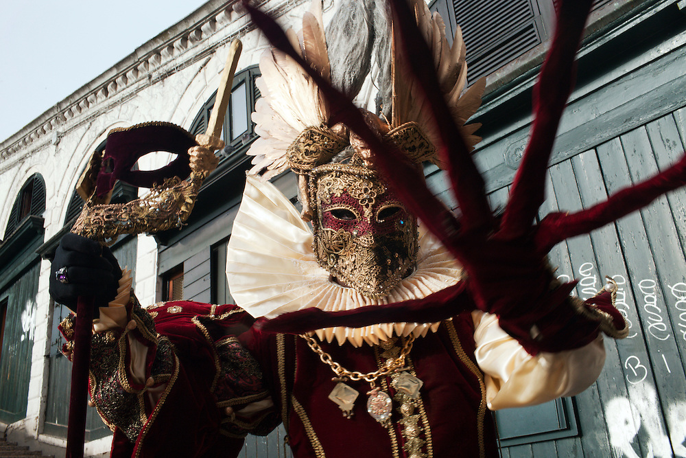 A Carnival Mask poses in Rialto bridge in Venice during the carnival.