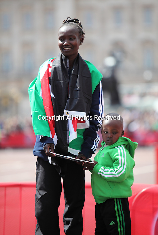 22.04.2012 London, England.The winner of the womens 2012 Virgin London Marathon Mary Keitany (Kenya) poses with her child.
