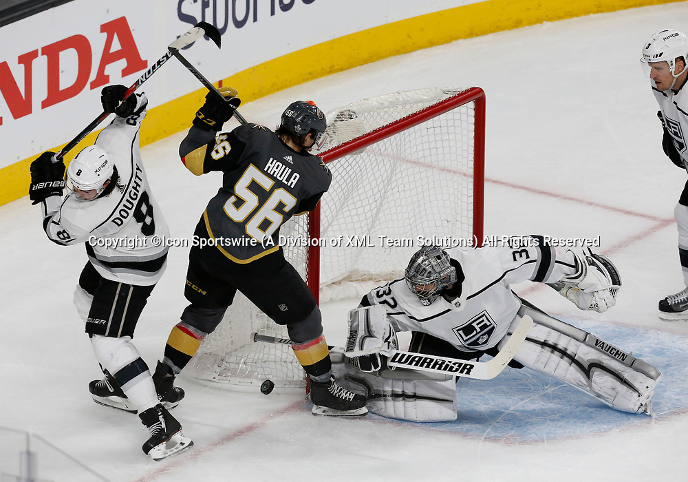LAS VEGAS, NV - APRIL 11: Los Angeles Kings goaltender Jonathan Quick (32) blocks a shot from Vegas Golden Knights left wing Erik Haula (56) during Game One of the Western Conference First Round of the 2018 NHL Stanley Cup Playoffs between the L.A. Kings and the Vegas Golden Knights Wednesday, April 11, 2018, at T-Mobile Arena in Las Vegas, Nevada. The Golden Knights won 1-0. (Photo by: Marc Sanchez/Icon Sportswire)